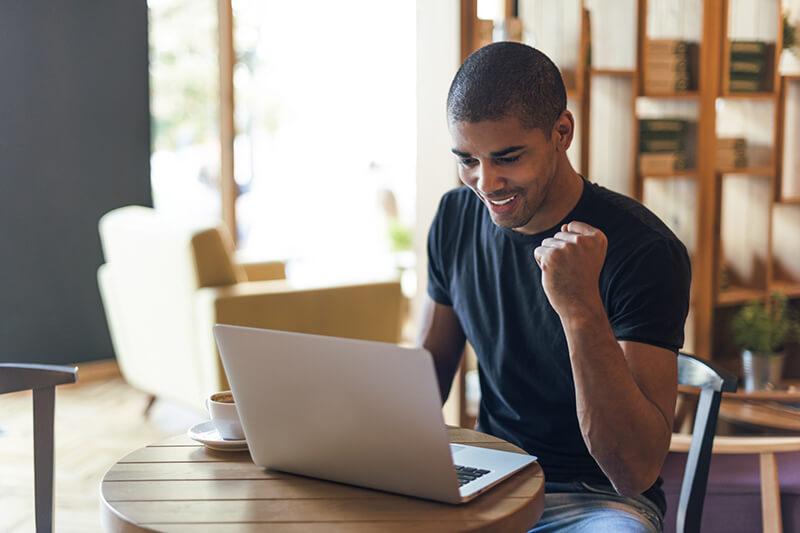 man celebrating his loan application approval
